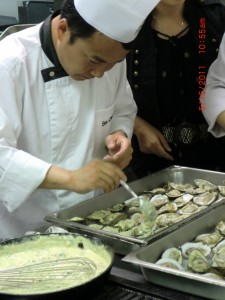 Preparing the Oysters Bienville.