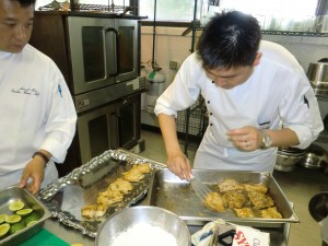 Plating the grouper onto the tray.